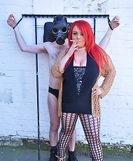 Mistress Jemstone hits guy in a gasmask then chains his cock