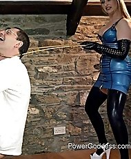 Latex Mistress with two slaves